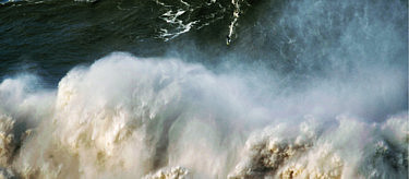 Vollebak athlete Andrew Cotton during the Big Sunday at Nazare, photo by Pedro Miranda