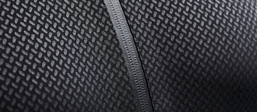 The rubberised, waterproof zip surround on the Condition Black Ceramic Baselayer. See more at vollebak.com