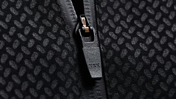 The Condition Black Ceramic Midlayer features a lock-down waterproof zip. See more at vollebak.com